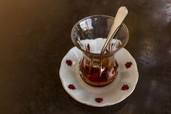 Traditional turkish tea for cups, plates and spoons royalty free stock photography