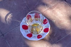 Traditional turkish tea glass on the table. At sunset time Stock Images