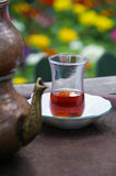 Traditional Turkish tea served. On a wooden table, outdoor Stock Photo