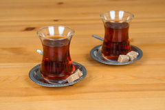 Traditional Turkish tea. Two cups of Traditional Turkish tea with brown sugar Stock Images