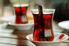 Traditional Turkish Tea. Two cups of traditional Turkish tea. One in foreground, and one in blurred background Stock Image