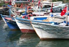 Traditional Turkish wooden fishing boats docked at Alanya Port. ALANYA,TURKEY-SEPTEMBER 18:Traditional Turkish wooden fishing boats docked at Alanya Port Royalty Free Stock Photography