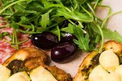 Traditional tuscan antipasto platter closeup. Royalty Free Stock Photo