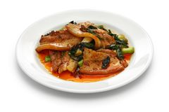 Traditional twice cooked pork. Sichuan style chinese dish  isolated on white background Stock Photo