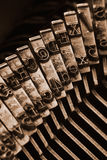 Traditional typewriter letterpress arms. Close up of antique typewriter typebars with focus on the @ symbol, great concept for blogs, journalism, news or the Royalty Free Stock Images