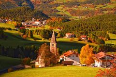 Traditional Tyrol church in alpine valley at autumn sunny day Royalty Free Stock Images