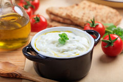 Traditional tzatziki sause on a table stock photography