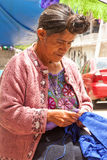 Traditional Tzotzil Woman at sewing stock image