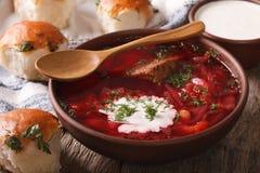 Traditional Ukrainian borsch soup close up in a bowl. horizontal. Traditional Ukrainian borsch soup close up in a bowl on the table. horizontal stock photography