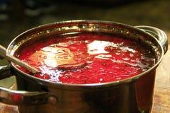 Traditional Ukrainian borscht. Borsch Ukrainian red in pan with scoop Royalty Free Stock Image