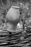 Traditional Ukrainian clay jug on wooden fence and Physalis alkekengi royalty free stock photos