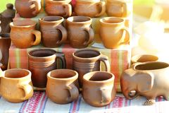 Traditional ukrainian cooking stove clay pots. Pottery Royalty Free Stock Photography