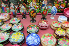 Traditional Ukrainian craft souvenirs. Souvenirs wooden board painted with colorful flowers and birds sold on the street in Andreevsky spusk in Kiev, Ukraine Royalty Free Stock Image