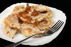 Traditional Ukrainian dumplings with bacon royalty free stock images