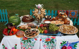 Traditional Ukrainian festive dinner meals. On open air Stock Image