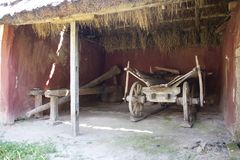 An ancient cart with wooden wheels under canopy stock images