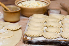 Traditional Ukrainian hand-made varenyky (pierogi ruskie in Pola. Raw traditional Ukrainian hand-made varenyky (pierogi ruskie in Poland) with cottage cheese Royalty Free Stock Photo