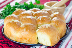 Traditional Ukrainian homemade bun (pampushka) with garlic Stock Photo