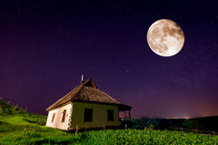 Traditional ukrainian house in old village under night sky Stock Photos