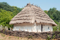 Traditional Ukrainian house with a thatched roof. Royalty Free Stock Photo