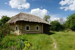 Traditional Ukrainian rural house with hay roof ,Pirogovo,Europe Royalty Free Stock Photo