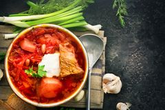 Traditional Ukrainian russian borscht. Plate of red beet root soup borsch on black rustic table. Beetroot soup Royalty Free Stock Photo