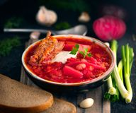 Traditional Ukrainian russian borscht. Plate of red beet root soup borsch on black rustic table. Beetroot soup. Ukrainian cuisine royalty free stock photos