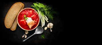 Traditional Ukrainian russian borscht. Plate of red beet root soup borsch on black rustic table. Beetroot soup top view. Flatlay. Traditional Ukrainian cuisine stock images
