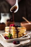 Traditional Ukrainian or Russian pancakes. Traditional dishes on the holiday Carnival Maslenitsa Shrovetide Dark rustic style phot. O stock photos