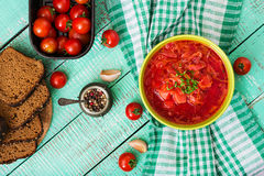 Traditional Ukrainian Russian vegetable borscht soup on green bowl. Stock Photos