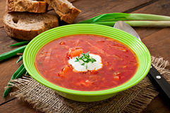 Traditional Ukrainian Russian vegetable borscht soup. On the old wooden background Royalty Free Stock Photo