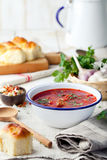 Traditional Ukrainian Russian vegetable soup, borsch with garlic donuts, pampushki. Traditional Ukrainian Russian vegetable soup, borsch with garlic donuts stock photos