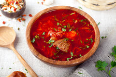 Traditional Ukrainian Russian vegetable soup, borsch with garlic donuts, pampushki . Traditional Ukrainian Russian vegetable soup, borsch with garlic donuts Royalty Free Stock Image