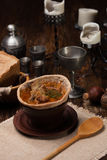 Traditional Ukrainian soup served in bread. Against the backdrop of a still life of a medieval Stock Photo