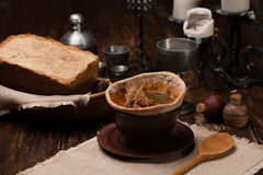 Traditional Ukrainian soup served in bread. Against the backdrop of a still life of a medieval Stock Images