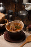 Traditional Ukrainian soup served in bread. Against the backdrop of a still life of a medieval Stock Photography