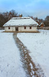 Traditional Ukrainian village in winter. Old house at Pirogovo ethnographic museum, Royalty Free Stock Photos