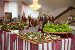Traditional ukrainian wedding feast table closeup with salads, m Stock Images