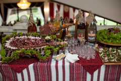 Traditional ukrainian wedding feast table closeup with salads, m Royalty Free Stock Photo