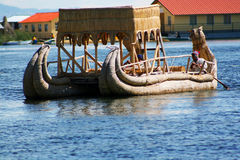 Traditional uros boat, in uros island, Puno, Peru Peruvian andes Stock Photos