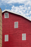 Traditional US red painted barn on farm. Red painted wooden barn with white door on farm in traditional US style Royalty Free Stock Image