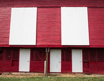 Traditional US red painted barn on farm. Red painted wooden barn with white door on farm in traditional US style Royalty Free Stock Photo