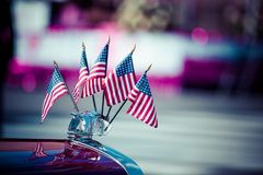 Traditional USA parade old car with flags Royalty Free Stock Photography