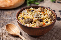 Traditional uzbek food called pilaf cooked with Stock Photography