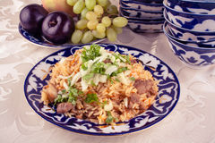 Traditional uzbek meal called pilaf and onion in vintage look Stock Photo