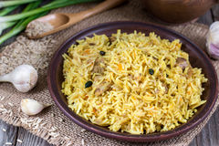 Traditional uzbek meal called pilaf Royalty Free Stock Photo