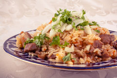 Traditional uzbek meal called pilaf in vintage look Royalty Free Stock Image