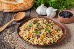 Traditional uzbek meal pilaf. Rice with meat Royalty Free Stock Image