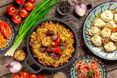 Traditional Uzbek oriental cuisine. Uzbek family table from different dishes in national dishes for the New Year holiday. The background image is a top view stock images