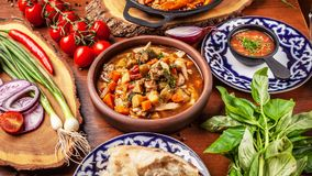 Traditional Uzbek Oriental Cuisine. Uzbek Family Table From Diff Royalty Free Stock Images